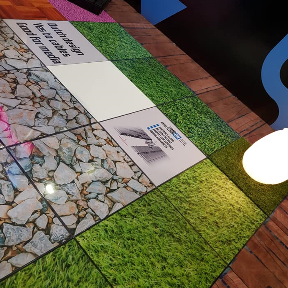 Exhibition floor tile with bespoke graphics